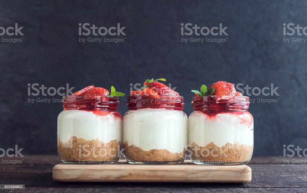 Sweet cheesecake with strawberries stock photo