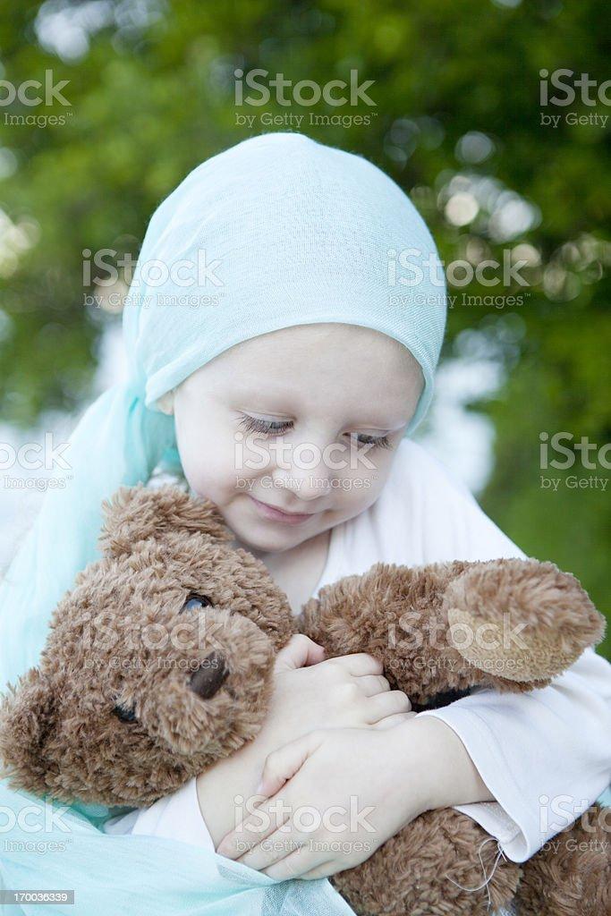 Sweet Chemo Girl Hugs Teddy Bear Vertical royalty-free stock photo