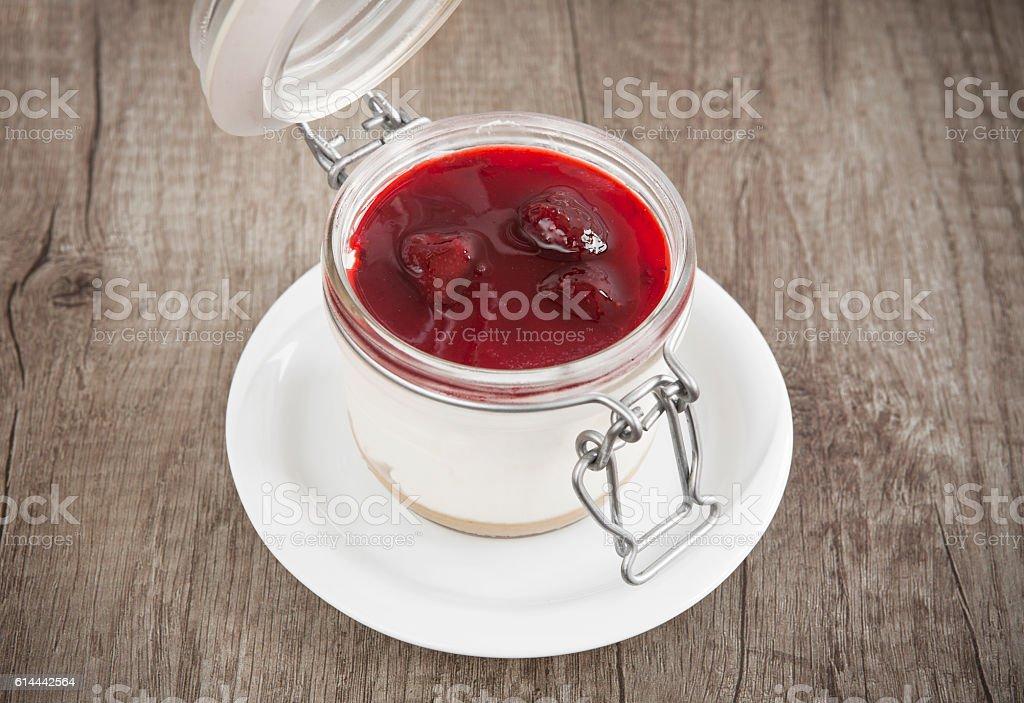 Sweet cherry cheesecake in a  jar stock photo