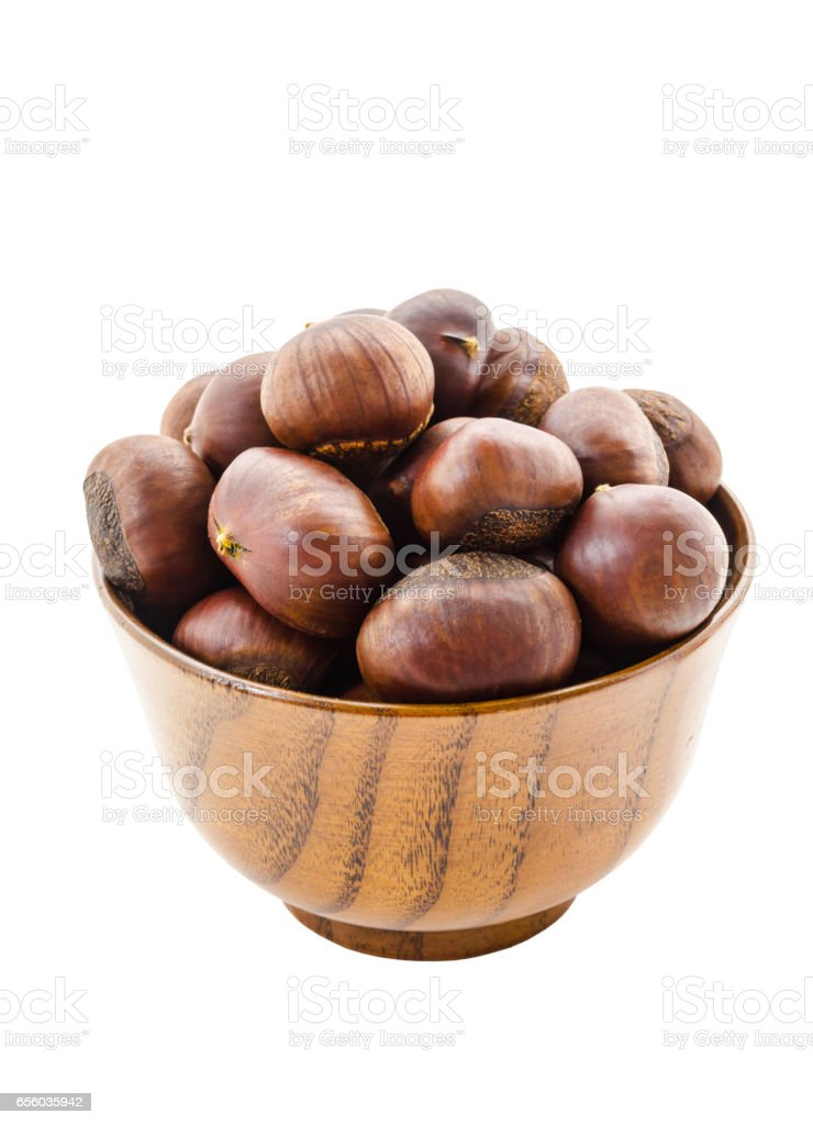 Sweet chestnut in wooden bowl stock photo