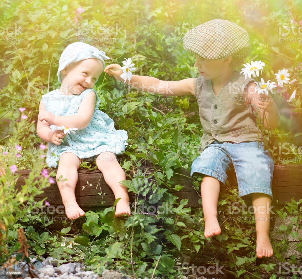 Sweet children romance stock photo