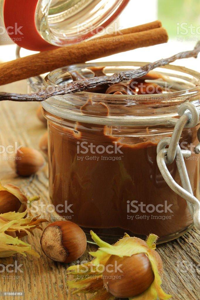 sweet chocolate cream in jar glass stock photo
