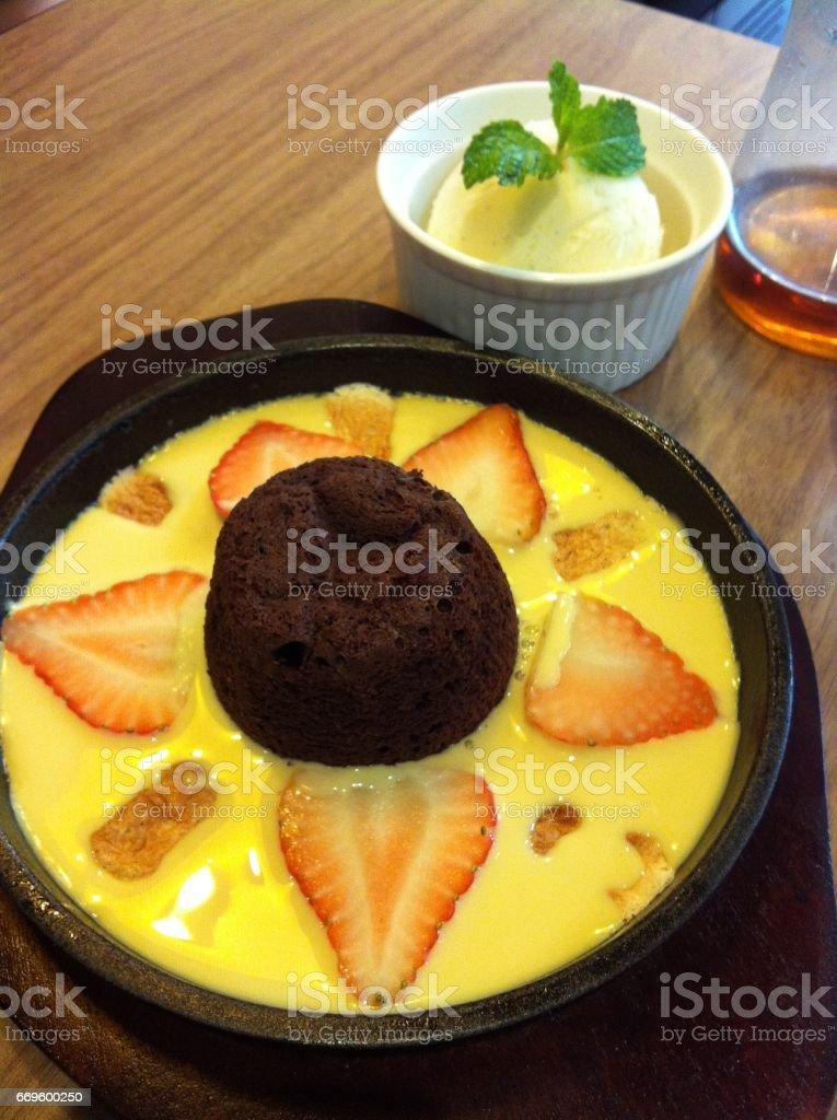 sweet chocolate lava on the vanilla sauce. stock photo