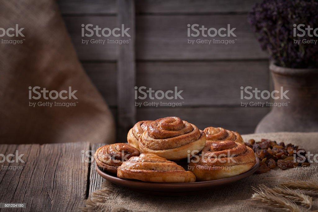 Sweet cinnamon bun rolls christmas delicious sweet dessert on vintage stock photo