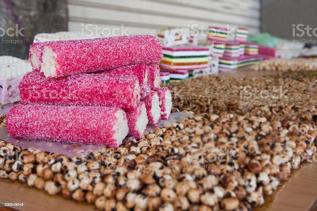 sweet coconut rolls piled on a snacks stand stock photo
