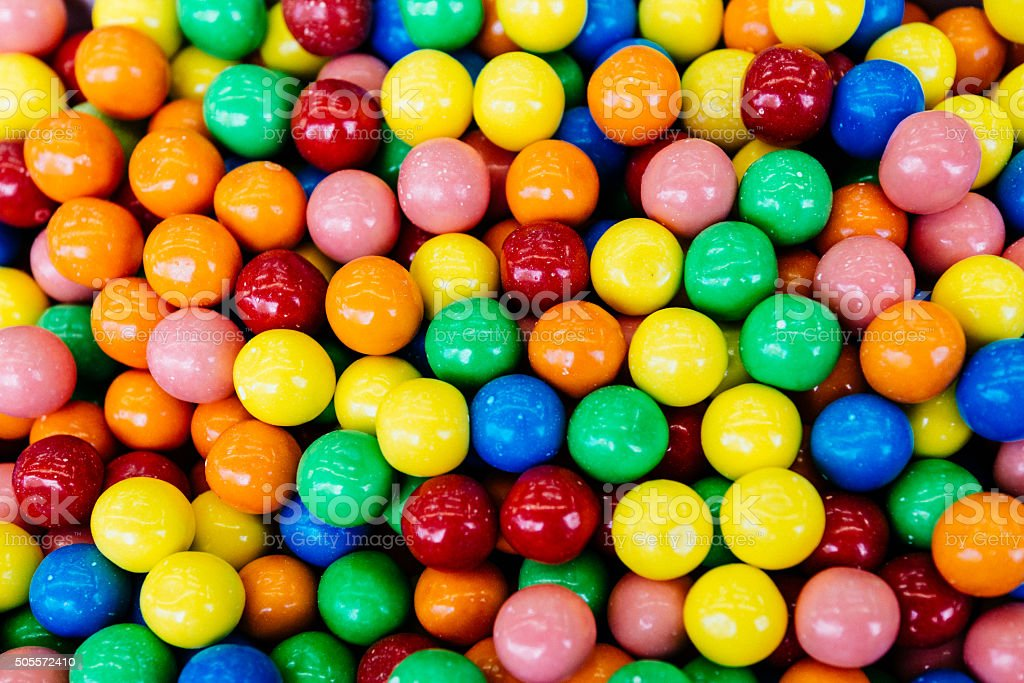 Sweet colorful candy balls in different colors on pile stock photo