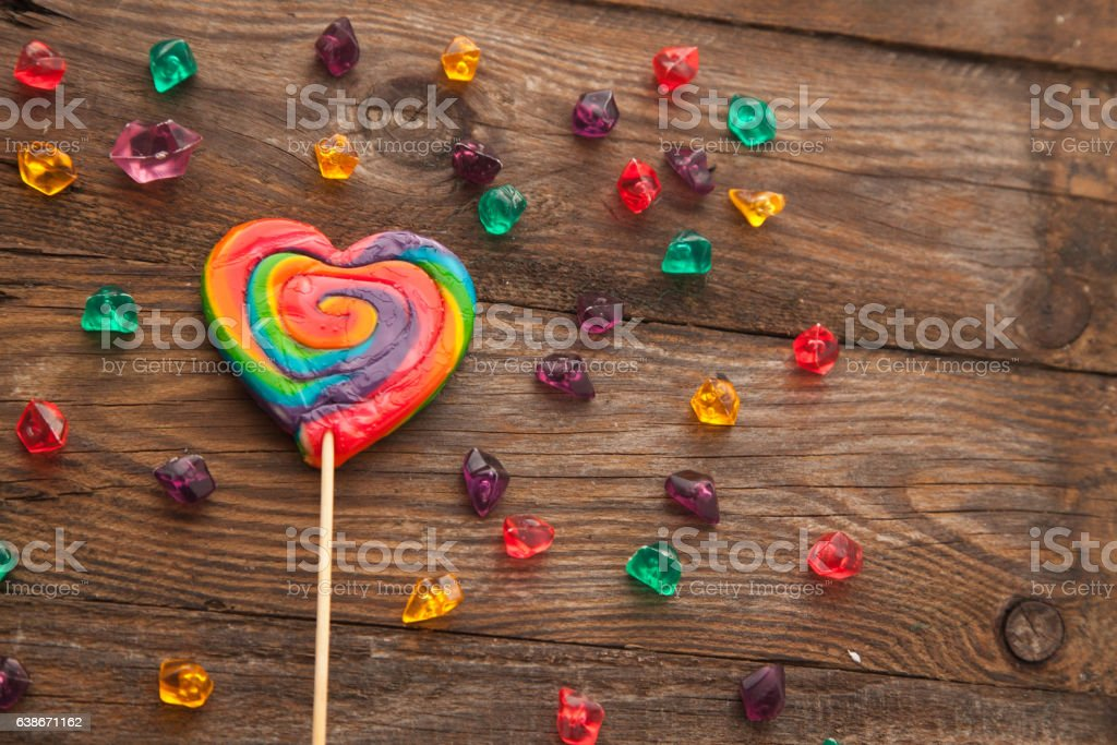 Sweet colorful lollipop in the shape of a heart. stock photo