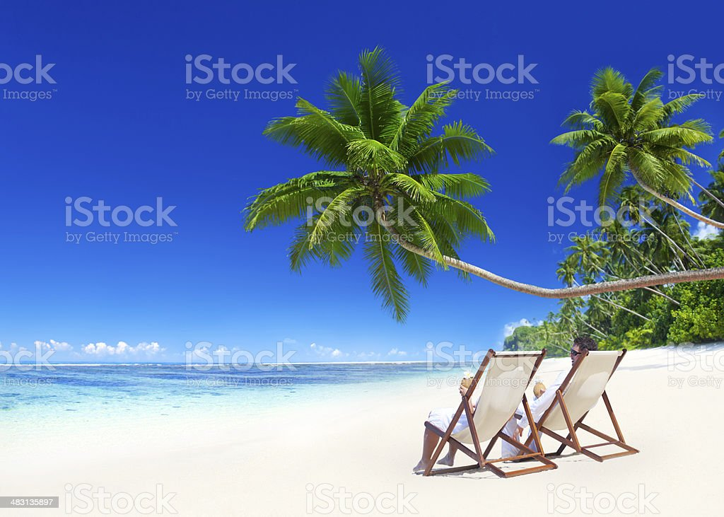 Sweet Couple Relaxing on the Beach stock photo
