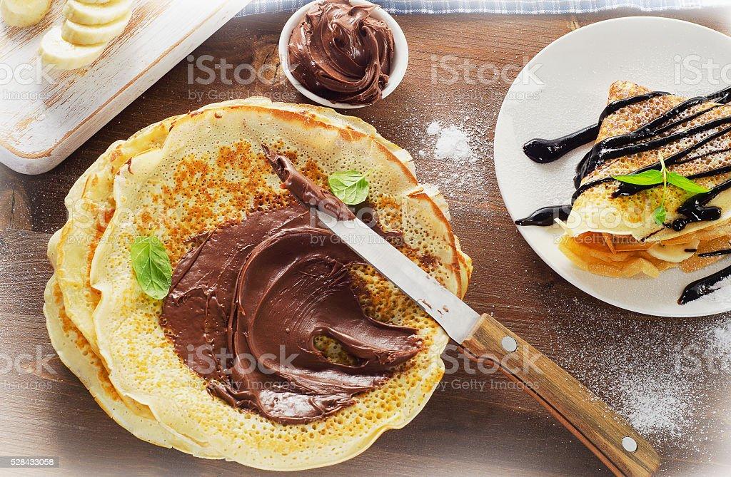 Sweet Crepes with chocolate cream. stock photo