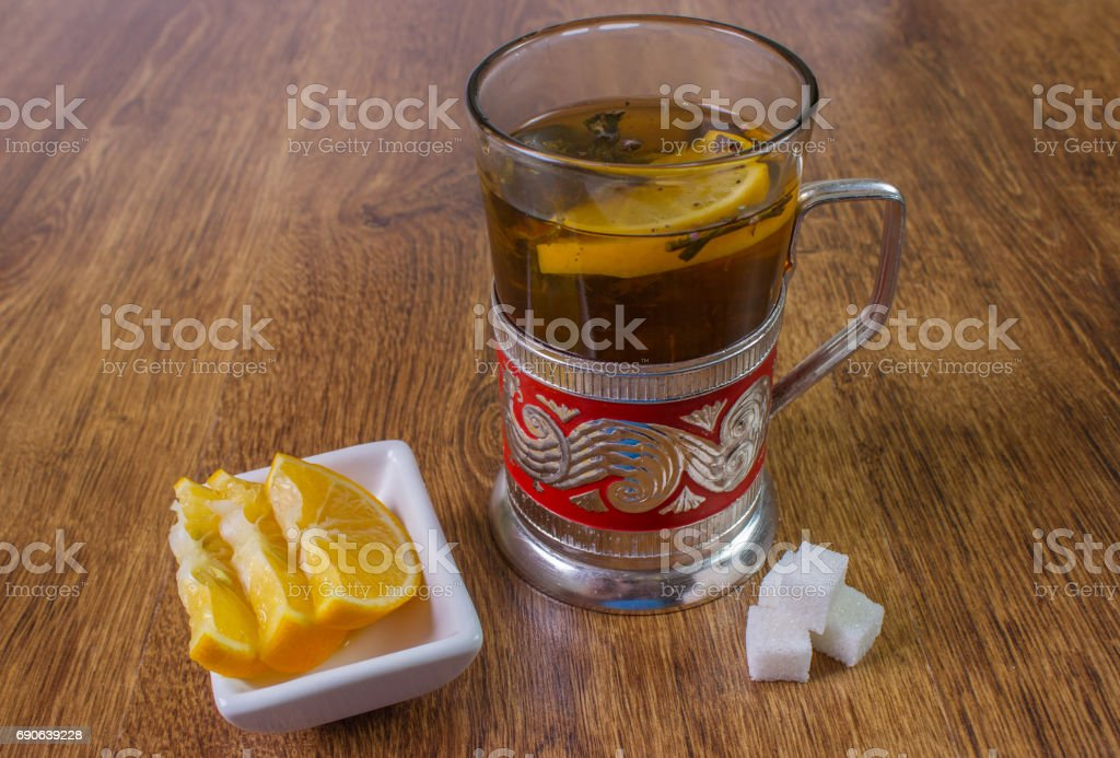 sweet cup of fruit tea with lemon and sugar. stock photo