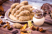 Sweet dessert with cookies, cocoa and milk