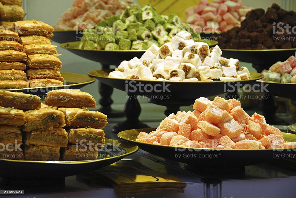 Sweet dried Fruit and Pastry on a display. stock photo