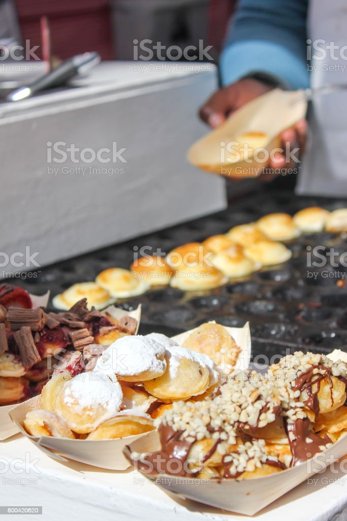 Sweet Dutch pancakes (poffertjes) stock photo