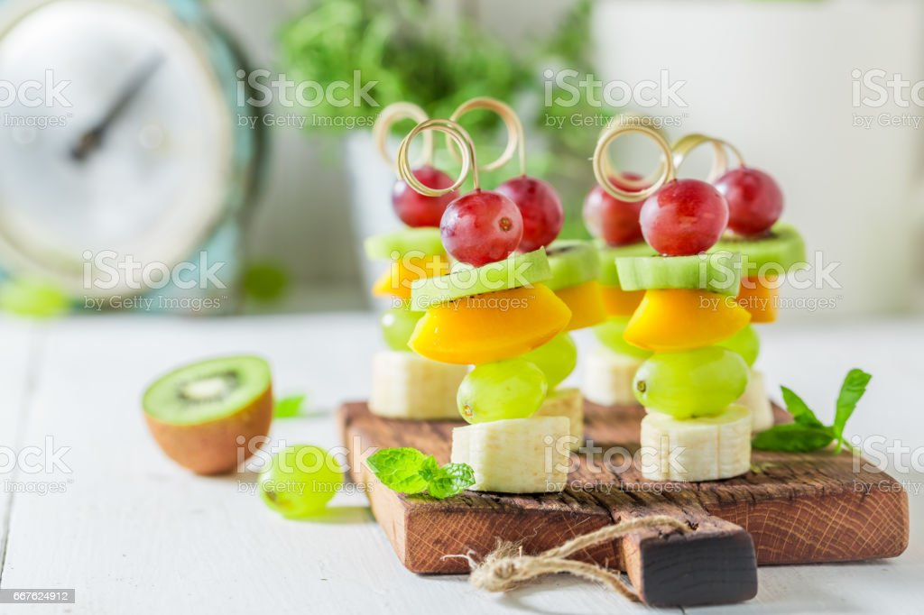 Sweet finger food with various fruits and mint for party stock photo