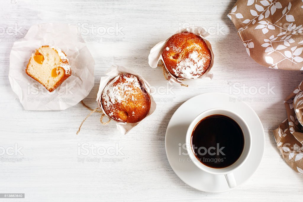 Sweet Fresh Baked Muffins with Cup of Coffee stock photo
