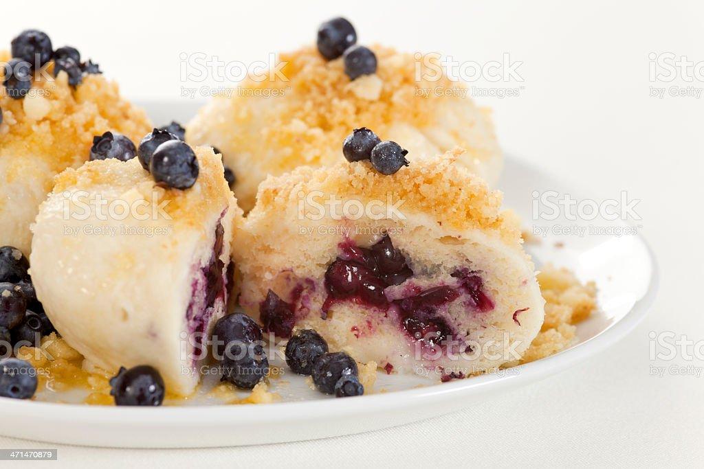 Sweet fruit dumplings with blueberries royalty-free stock photo