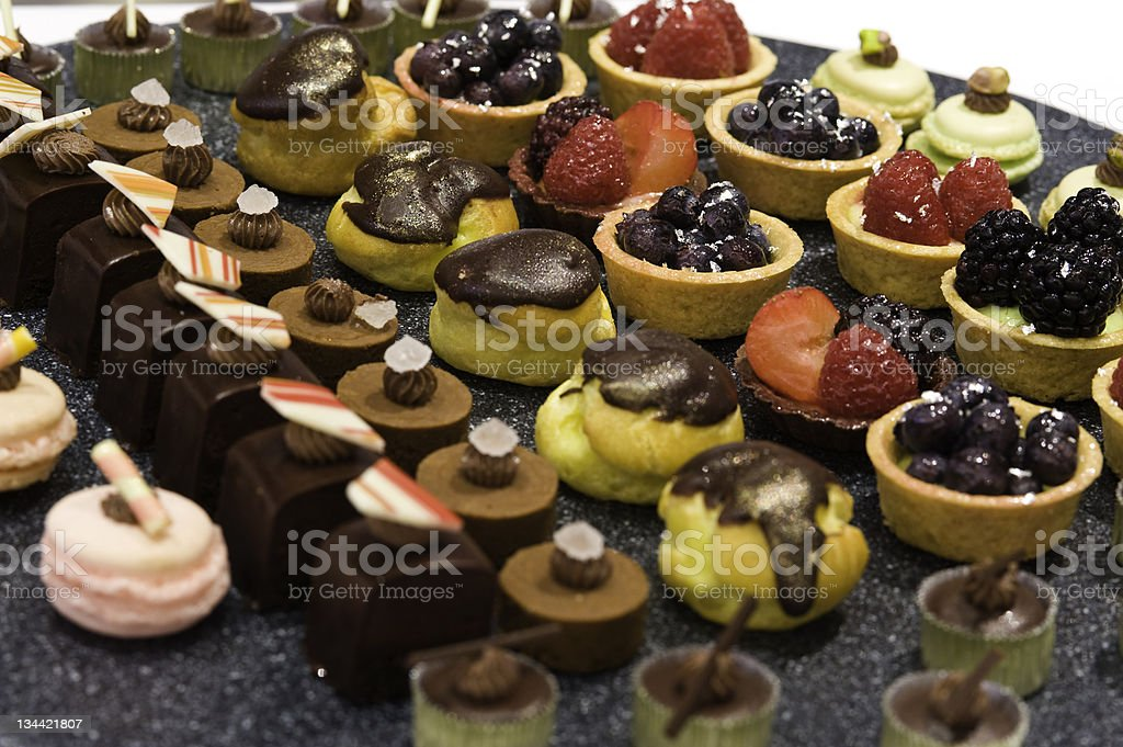 Sweet Fruit Tarts and Mini Chocolate Desserts royalty-free stock photo