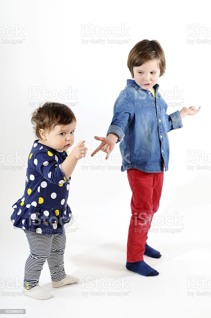 Sweet girl and boy playing together stock photo