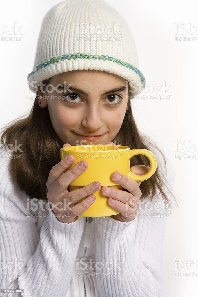 Sweet girl drinking hot beverage royalty-free stock photo