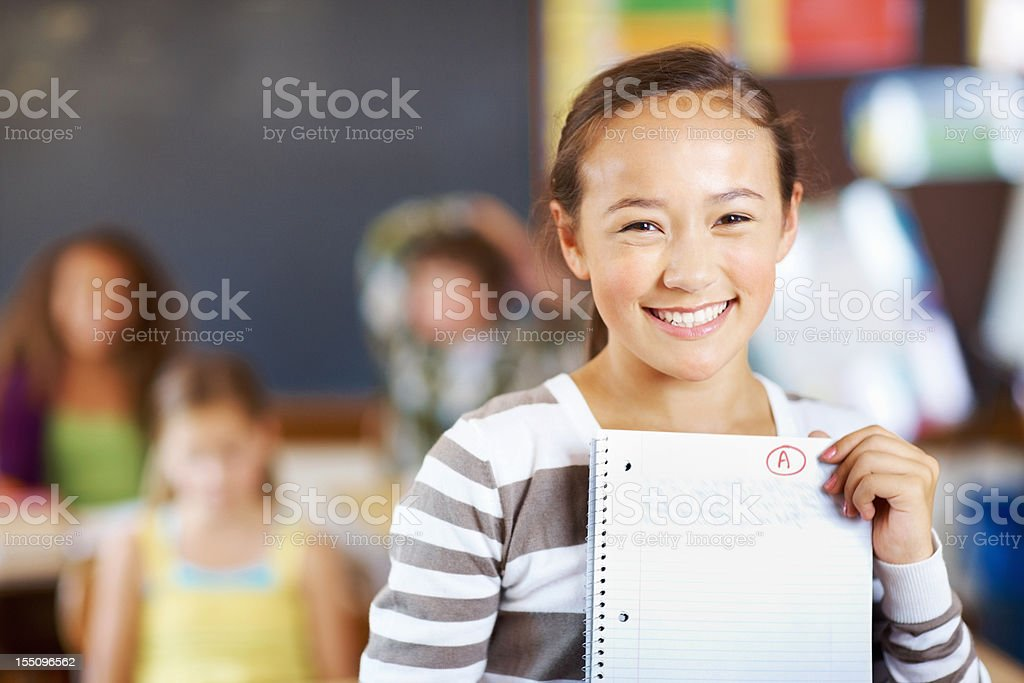 Sweet girl holding paper royalty-free stock photo