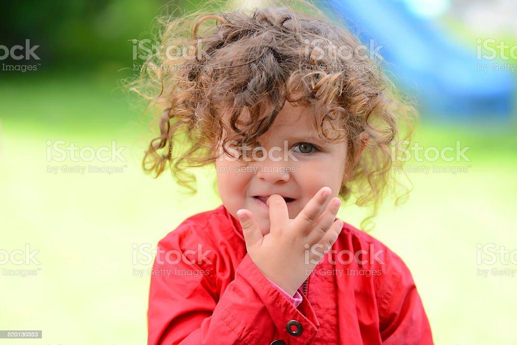 Sweet girl nail biting stock photo