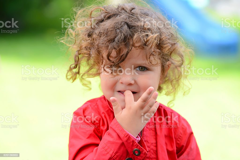 Sweet girl nail biting stock photo