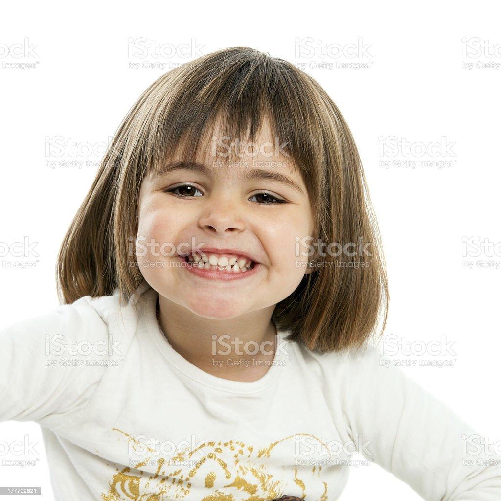 Jolie fille montrant les dents. photo libre de droits