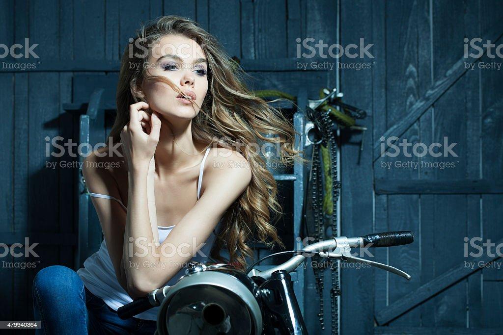 Sweet girl sitting on motorcycle stock photo