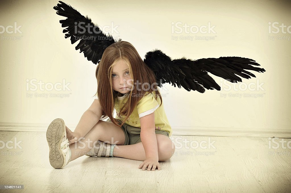 sweet girl wit artificial wings royalty-free stock photo