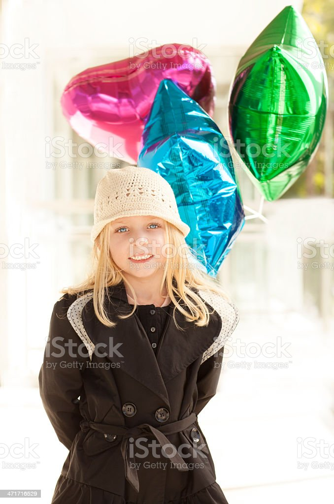 Sweet girl with a few baloons royalty-free stock photo
