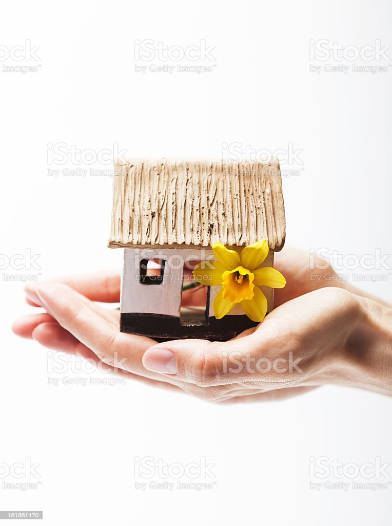 Sweet Home. Hand Holding and Protecting a small house model. royalty-free stock photo