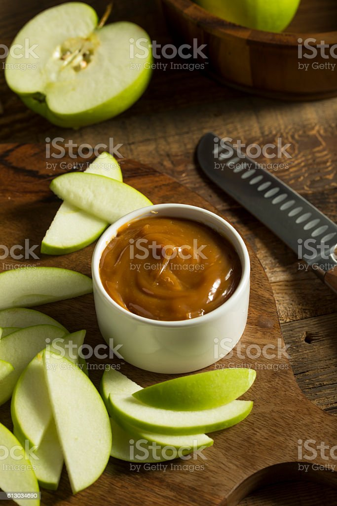 Sweet Homemade Caramel Dip with Sliced Apples stock photo