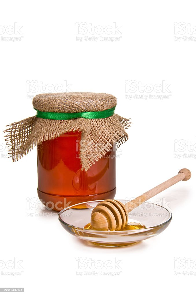 Sweet honey in jar with drizzler stock photo