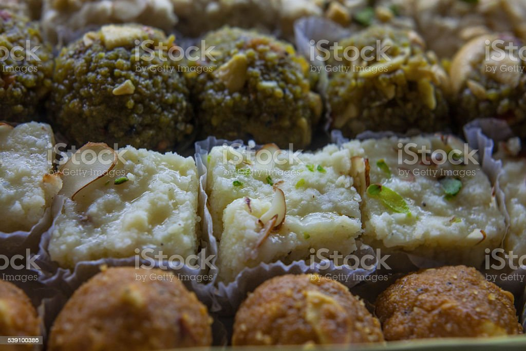 Sweet indian dish on indian market stock photo