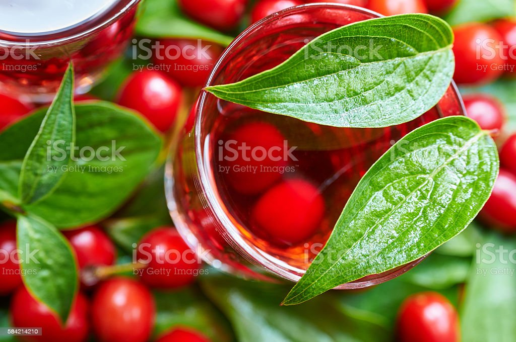 Sweet liqueur made from ripe cornelian cherry and alcohol stock photo