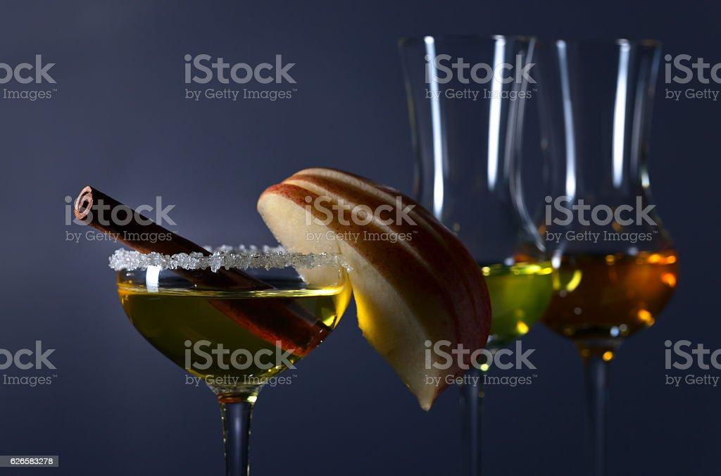 sweet liquor with apple and cinnamon stock photo