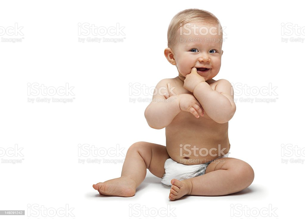 Sweet little boy sitting with finger in the mouth royalty-free stock photo