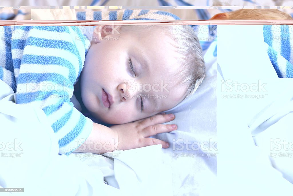 Sweet little boy sleeping in bed royalty-free stock photo