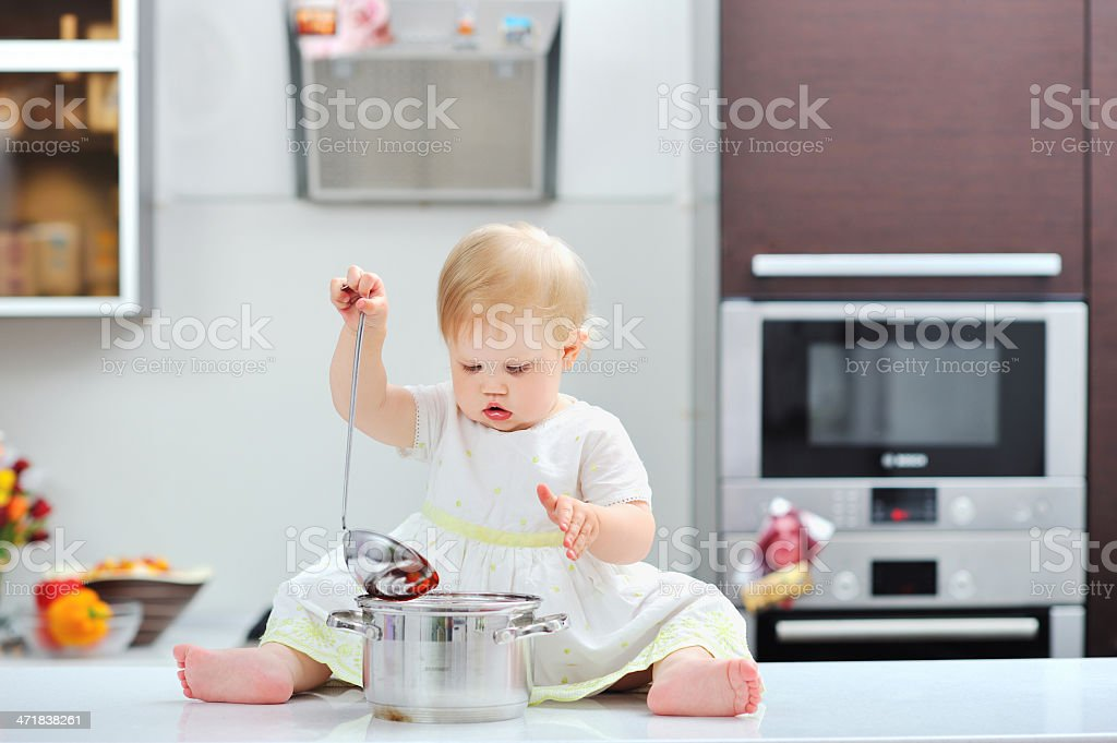 Sweet little girl cooking on a kitchen royalty-free stock photo