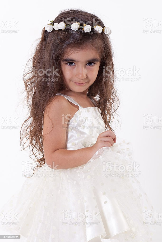 sweet little girl with  white dress posing, stock photo
