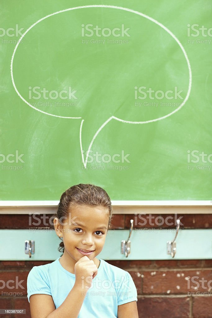 Sweet little school girl having a thought bubble royalty-free stock photo