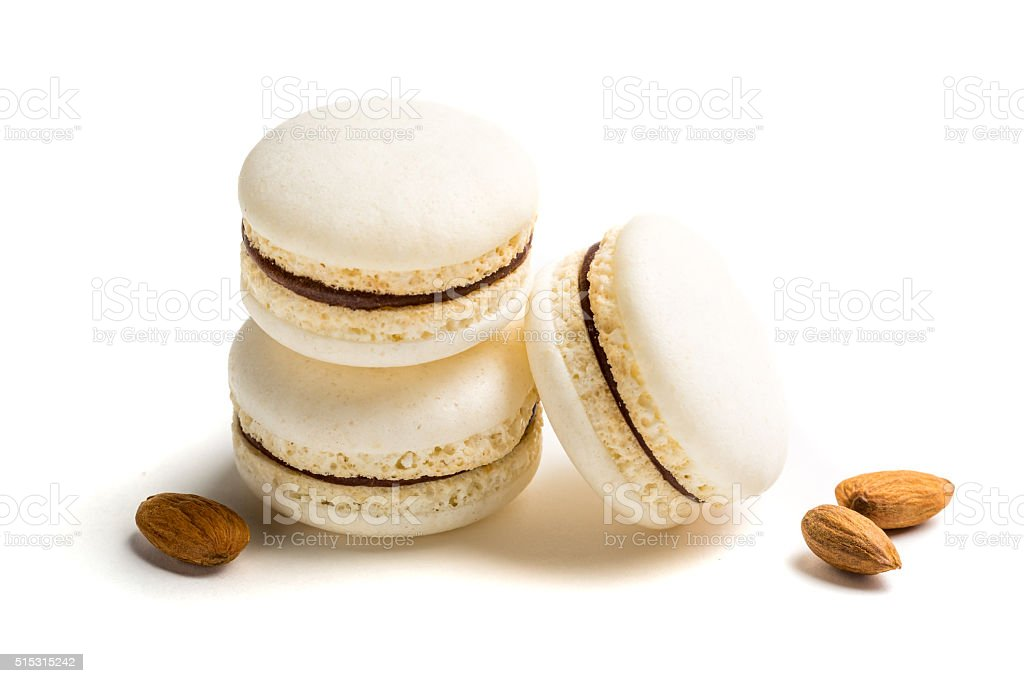 Sweet macaroons with almond on white background stock photo