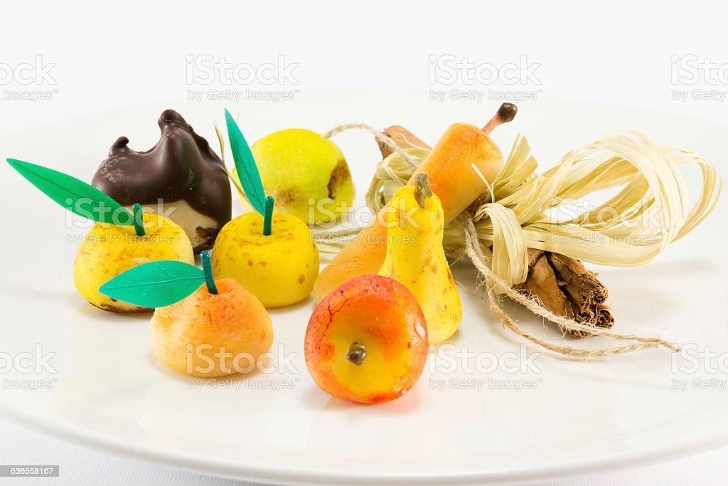 sweet marzipan fruit candies dessert with cinnamon stick decorat stock photo