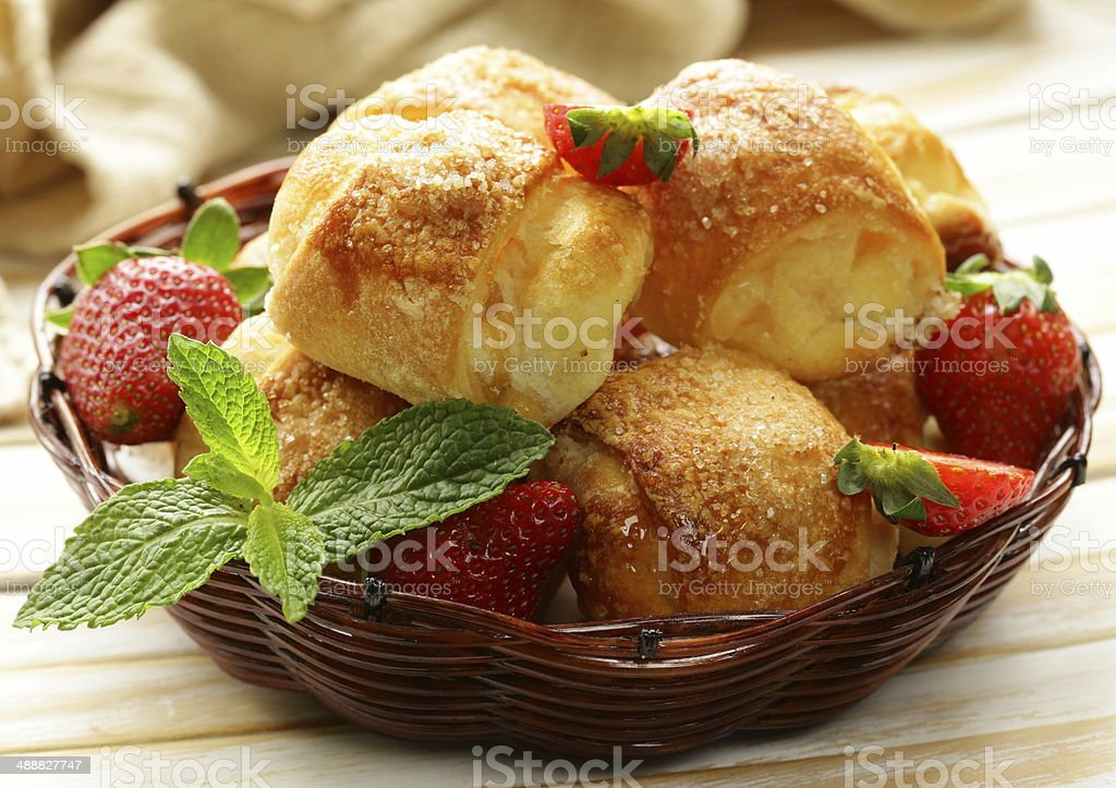 sweet muffins with strawberries and sugar - homemade pastries stock photo