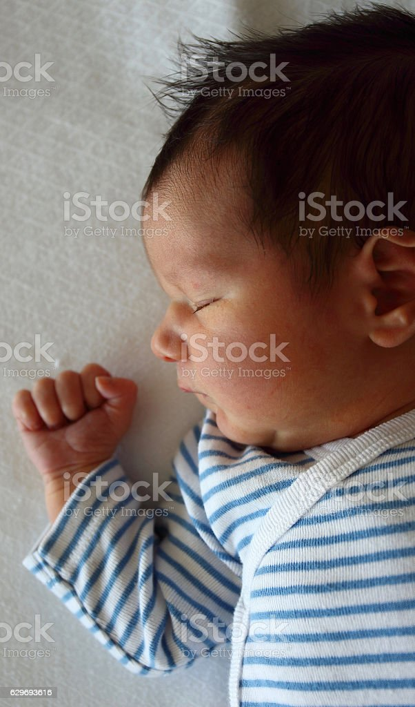 Sweet newborn little baby lying on the bed stock photo