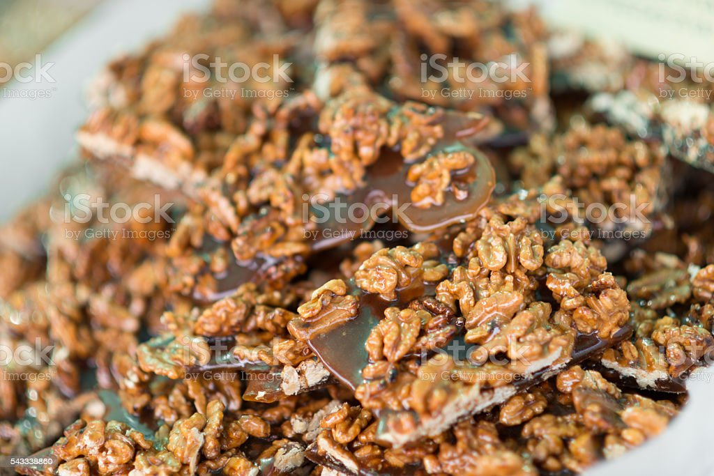 sweet nut honey candy slices for selling on market stock photo