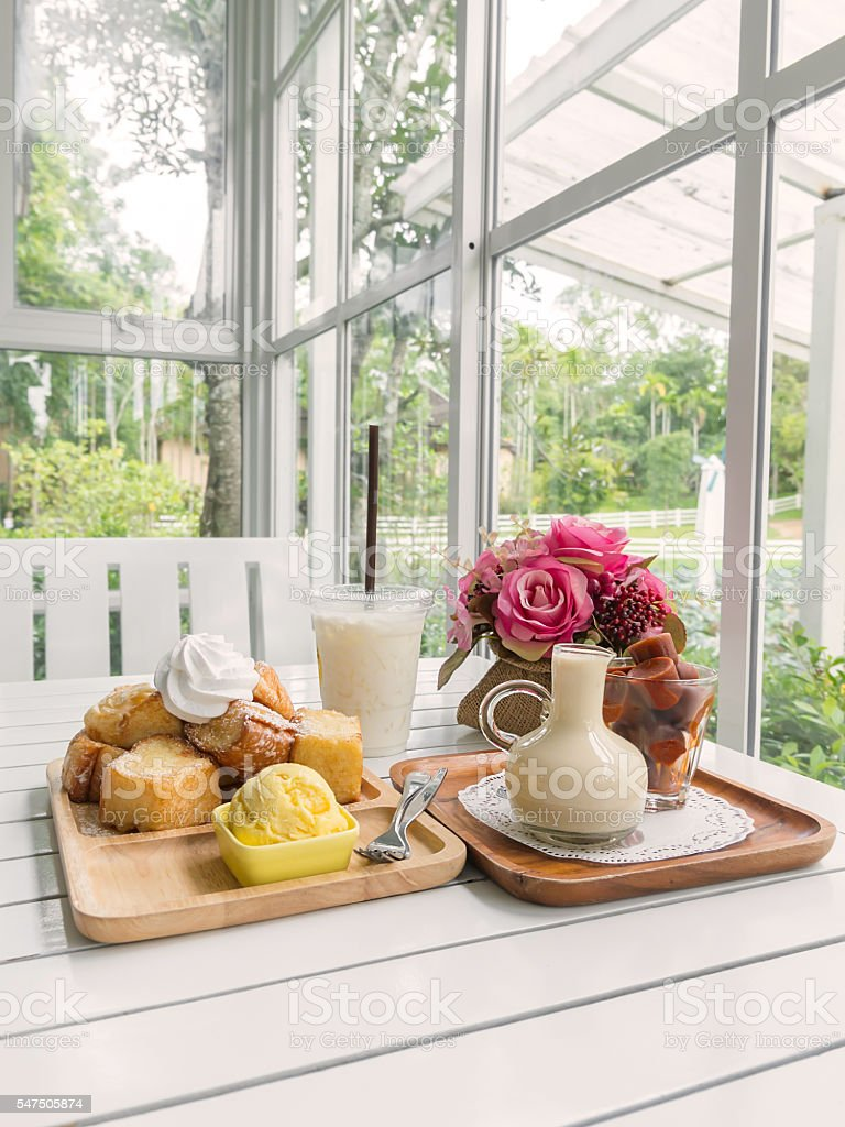 Sweet on table setting by the window stock photo