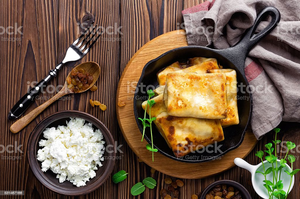 sweet pancakes stuffed cottage cheese stock photo