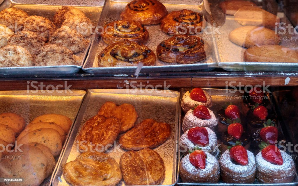 Sweet pastries in a bakery window stock photo
