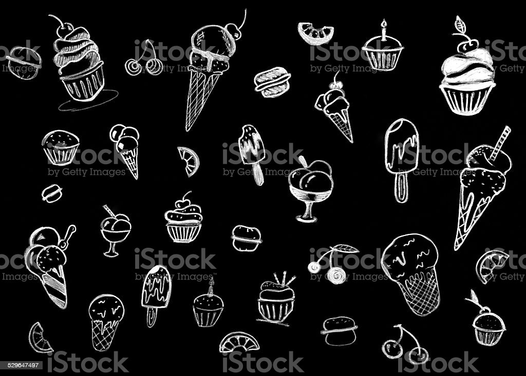 Sweet pastries on chalkboard stock photo